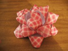 DIY Gift Bow. It would be a good and fun idea to use old magazines to make the bows.