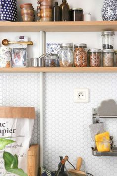 Removable, peel-and-stick subway tile. The kind you can install over your existing tile in an afternoon, without any special tools or tricks.