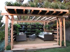 Jamie took ideas he gleaned from the green movement in Los Angeles to create a living wall for a new pergola. Irrigation tubes line the wall, which is packed with vegetables, herbs and perennials. The roof is a mixture of grasses and agave. — Image courtesy of jamiedurie.com Living Wall, Decks, Outdoor Rooms, Backyards Retreat, Vertical Gardens, Cozy Spaces, Patios, Outdoor Spaces, Hanging Gardens