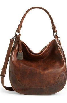- Styled after Frye's signature Melissa boot, this classic hobo bag is crafted in gorgeous washed leather and punctuated with burnished metal buttons. - Hidden magnetic snap closure - Optional, adjust