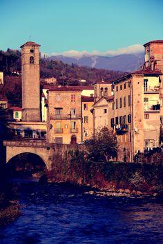 Turrite river that runs through Castelnuovo di Garfagnana, behind a view of the Dome.