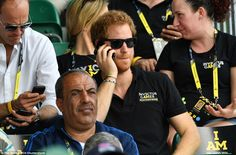 Calling home? Prince Harry made a quick phone call as the excitement built ahead of the track and field events today