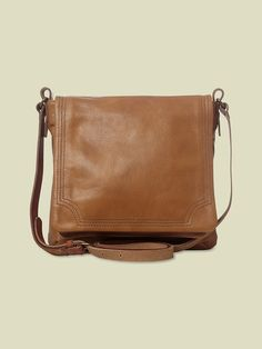 Our Michelle bag is crafted from soft leather; featuring an adjustable shoulder strap for ease of wear and secure magnetic fastening for peace of mind. Inside this bag is fully lined and has extra pockets and pouches for those little essentials. 25x20x5cm