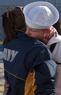 A Sailor assigned to the guided-missile destroyer USS Chung-Hoon (DDG 93) gives his farewells as the ship prepares to depart Joint Base Pearl Harbor-Hickam for an independent deployment to the Indo-Asia-Pacific region. The ship and its crew will conduct integrated operations in conjunction with allies and partners. (U.S. Navy photo by Mass Communication Specialist 3rd Class Diana Quinlan/Released)