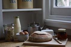 Fresh bread, jam, eggs and milk