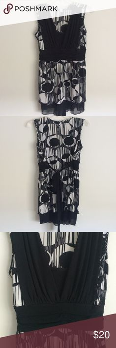 Black & White Flirty Top Fun & Flirty top! 94% polyester, 4% spandex. Ties in back to accent waistline. Sheer black lining falls just above knees for extra sassiness. Tops Blouses