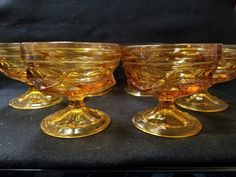 These are 6 amber Fostoria Jamestown thumb print sherbet glasses, dessert glasses. Set of 6.   3 1/4  inches tall, 3 1/2 inches in diameter.  Great detail, lovely amber color and interesting design.  Great for a retro Bar or Mad Man Bar.          To view more glassware from my shop click on the following link:  https://www.etsy.com/shop/DigginThruTheAttic/edit?ref=edit_trust_header§ion_id=19056228 | Shop this product here: http://spreesy.com/DigginThurTheAttic/1479 | Shop all of our products…