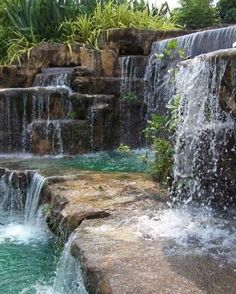 Now really, who has this in their backyard?  Pretty realistic for a manmade waterfall I must say.