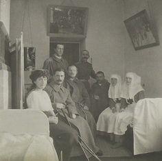 "Grand Duchesses Olga,Tatiana and Anastasia Nikolaevna Romanova of Russia with wounded soldiers during WWl. ""AL"""