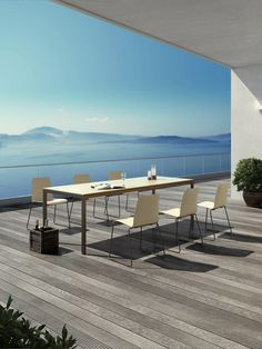 Oline, by Viteo, Austria. Aesthetically clean modern design furniture, with tables in a range of different sizes, and stackable chairs. Furniture is made from chestnut powder coated 316 stainless steel and sand colour Corian.