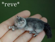 This tabby and white miniature peek-a-boo cat was hand sculpted from polymer clay with delicate wire in the legs, neck and tail. Her coat was applied with tweezers and glue using alpaca fiber...