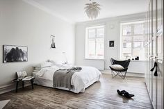 A grey-scale Swedish apartment with a dreamy bedroom