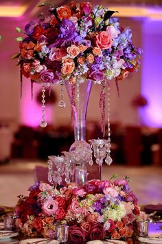 Warm and looks like a collection of wild flowers. From 25 Stunning Wedding Centerpieces - Part 7 - Belle the Magazine . The Wedding Blog For The Sophisticated Bride