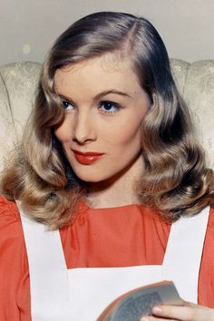 Catherine's friend Poppy was injured in the war and covered her scar with a Veronica Lake style hairdo.