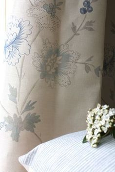 Sarah Hardaker - Rupali Fabric Collection - A large, subtle floral pattern in grey and light blue, printed on cream coloured curtains, beside a plain pale blue coloured scatter cushion Cream Lounge, Lounge Curtains, Beige Bed Linen, Luxury Bedding Sets, Roman Blinds, Scatter Cushions, Linen Bedding, Bed Pillows, Tapestry