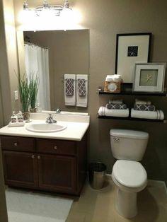 Shelves above the toilet basement bathroom