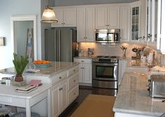 perfect cabinets. open and enclosed, traditional enough without being boring, bright, fresh, open kitchen