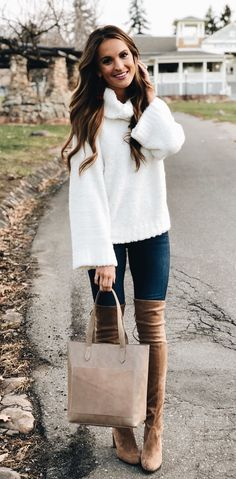 #winter #outfits white sweater, blue denim jeans, and pair of thigh-high boots outfirt