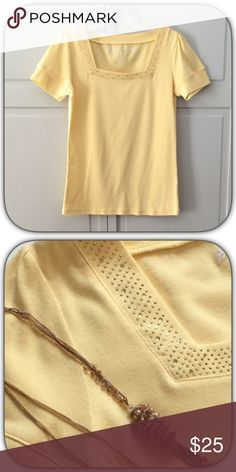 Soft Yellow Gold Rhinestone T-Shirt This is a pretty soft tee with sparkles of gold Rhinestones around the neckline! The color is so pretty for the spring season! Boutique Tops Tees - Short Sleeve