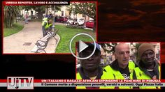 Un italiano e alcuni immigrati africano verniciano le panchine a Perugia