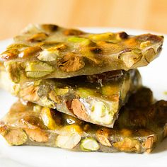 Pistachio Brittle - A delicious spin on traditional peanut brittle! Candy Recipes, Sweet Recipes, Holiday Recipes, Christmas Recipes, Christmas Treats, Christmas Stuff, Christmas Cookies, Yummy Recipes, Christmas Cards