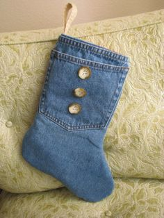 This is the THIRD stocking on the far right in the group photo! I made this denim Christmas stocking from an old pair of jeans, lined it with a