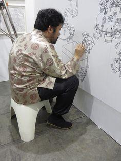 Shintaro Miyake stealing the show - drawing on the wall whilst perching on a Sori Yanagi stool at Art Basel 2015