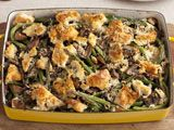 This is a Gourmet version of the traditional Green Bean Casserole. I make it every year for Thanksgiving, and it is DELICIOUS. With fresh herbs, crusty bread croutons, and a wild mushroom cream sauce, you can't beat it. Definitely beats the Campbell's version (and that's always been one of my favorites!).