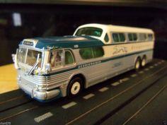 http://www.ebay.com/itm/Greyhound-Los-Angeles-Scenicruiser-Bus-Custom-HO-Slot-Car-Vintage-AFX-4-Gear-/262229739888?hash=item3d0e1c4970:g:Zz8AAOSwzrxUyC2U