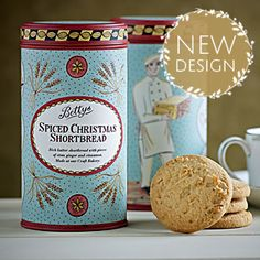 Bettys Spiced Christmas Shortbread Caddy | Our classic all-butter shortbread, given a festive touch with stem ginger and seasonal spice. Presented in a stylish new tin, illustrated by Yorkshire-based artist Emily Sutton.