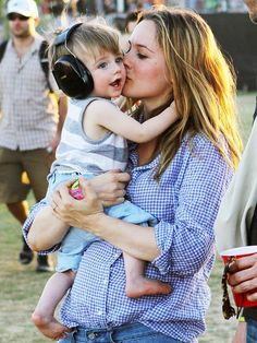 Alicia Silverstone, protecting her son's ears at a concert