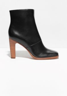These dressy ankle boots are cast in buttery calf leather fixed on a contrasting block-heel base.