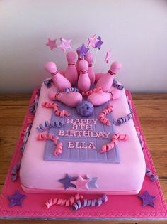 Girls bowling party birthday cake. I used a mould to make the pins and the spirals were made by wrapping strips of flower paste around a pencil.