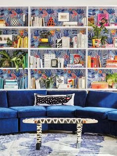 Blue floral DIY wallpaper in living room with velvet blue couch