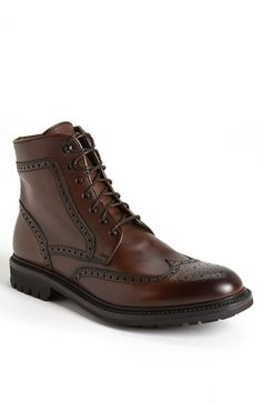 Rich, lustrous leather forms a classic boot paneled in wingtip-style broguing. Color(s): dark brown. Brand: LOTUSSE. Style Name: Lottusse Wingtip Boot.