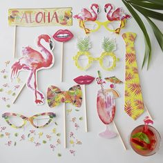 We're loving these tropical themed photo booth props! They are perfect for bringing the guests together and creating some memorable photos from your summer party or bbq! - Flamingo Fun at GingerRay.co.uk