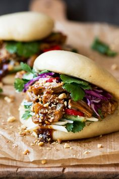 Vegan bao buns are to die for and easy to make. They are filled with succulent jackfruit in a salty-sweet marinade, crunchy veggies, peanuts and herbs.