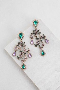 Purple and green oversized vineyard earrings with floral stone accents. Wear this statement earrings to show off a little enchantment.