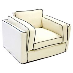 Upholstered club chair with contrasting trim and a wood frame.       Product: Chair    Construction Material: Wood frame, fabric and fire retardant foam cushions   Color: White and black   Features: Fashion-forward design    Dimensions: 25 H x 47 W x 38 D