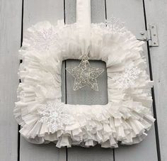 Cheap winter wreath made from coffee filters, cardboard and tree ornaments. Try making a fall wreath by dyeing the filters with tea!