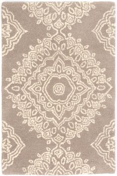 Dash & Albert | Lace Medallion Wool Tufted Rug | With its goregeously intricate Indian-inspired pattern, this tufted wool area rug is the perfect way to add a subtle touch of pattern to any room.