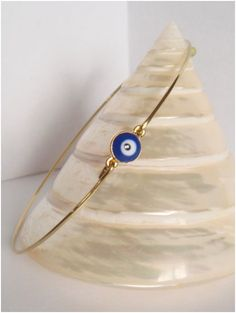 Gold and dark blue evil eye bangle  Evil eye bracelet  by Cecileis, $11.00