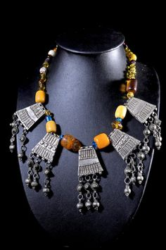 Africa | Necklace from the Oromo people of Ethiopia.  Mixed metal pendants, African 'amber', glass beads and white metal beads.  ca. 1970/80 | 350€