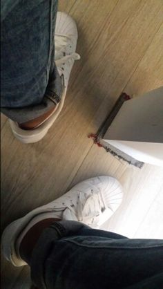 All white superstars with rolled-up jeans
