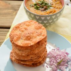 A traditional Sindhi breakfast recipe that consists of fried puris, served with dal