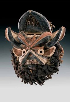Africa | 'Gla' mask from the We people of Ivory Coast | Wood, pigment, textile, vegetal fibers, hair