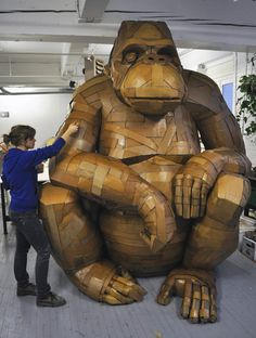 """""""Gorilla"""" cardboard sculpture - by Laurence Vallières (2012);  """"Presented at the Fresh Paint Gallery for the Festival Montreal en Lumières, it became my trademark for the time to come.""""  9.2' high x 7' wide x 5' deep"""