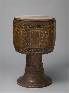 Tombak Date: late 19th century Geography: Iran (Persia) Culture: Persia Medium: Various woods, bone, brass, skin Dimensions: H.: 56.5 cm (22...