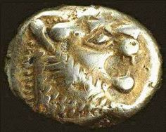 About 2,700 years old. From western Turkey, this could be the oldest coin found to date. In the British Museum. Made with electrum, an alloy of gold and silver.