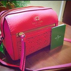 NWT Kate Spade Crossbody Brand New pink floral eyelet Crossbody from Kate Spade. Mede from genuine leather and feature gold hardware. kate spade Bags Crossbody Bags
